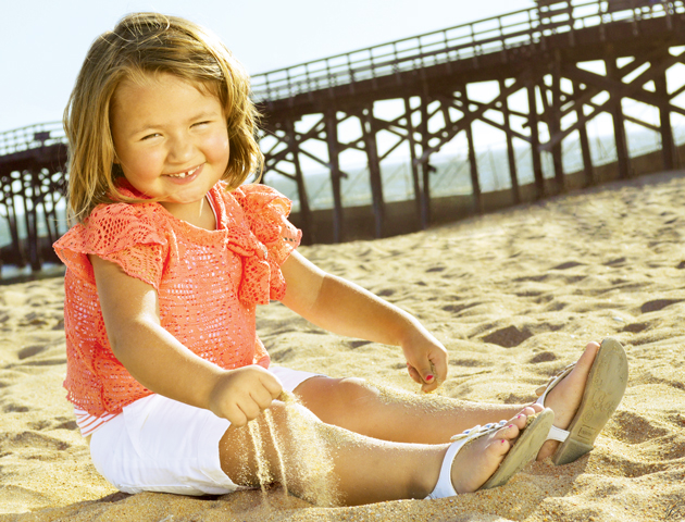 Ella plays in the sand in Seal Beach